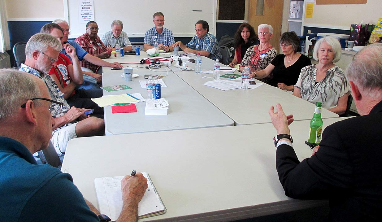 HCAO Board in discussion with T.R. Reid
