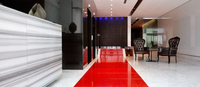 african pride hotel reception desk with red carpet.jpg