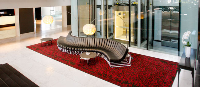african pride hotel cape town south africa curved sofa in reception designer carpet.jpg