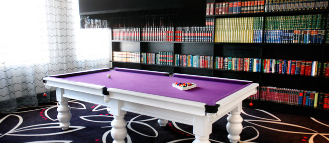 african pride hotel white billiard table with purple felt in library.jpg