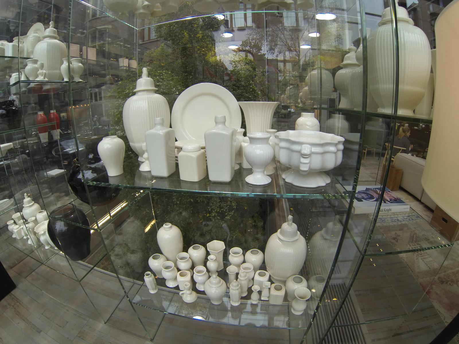 white-dutch-ceramics-on-display-in-glass-freestanding-shelving-in-lobby-conservatorium-hotel-amsterdam.jpg