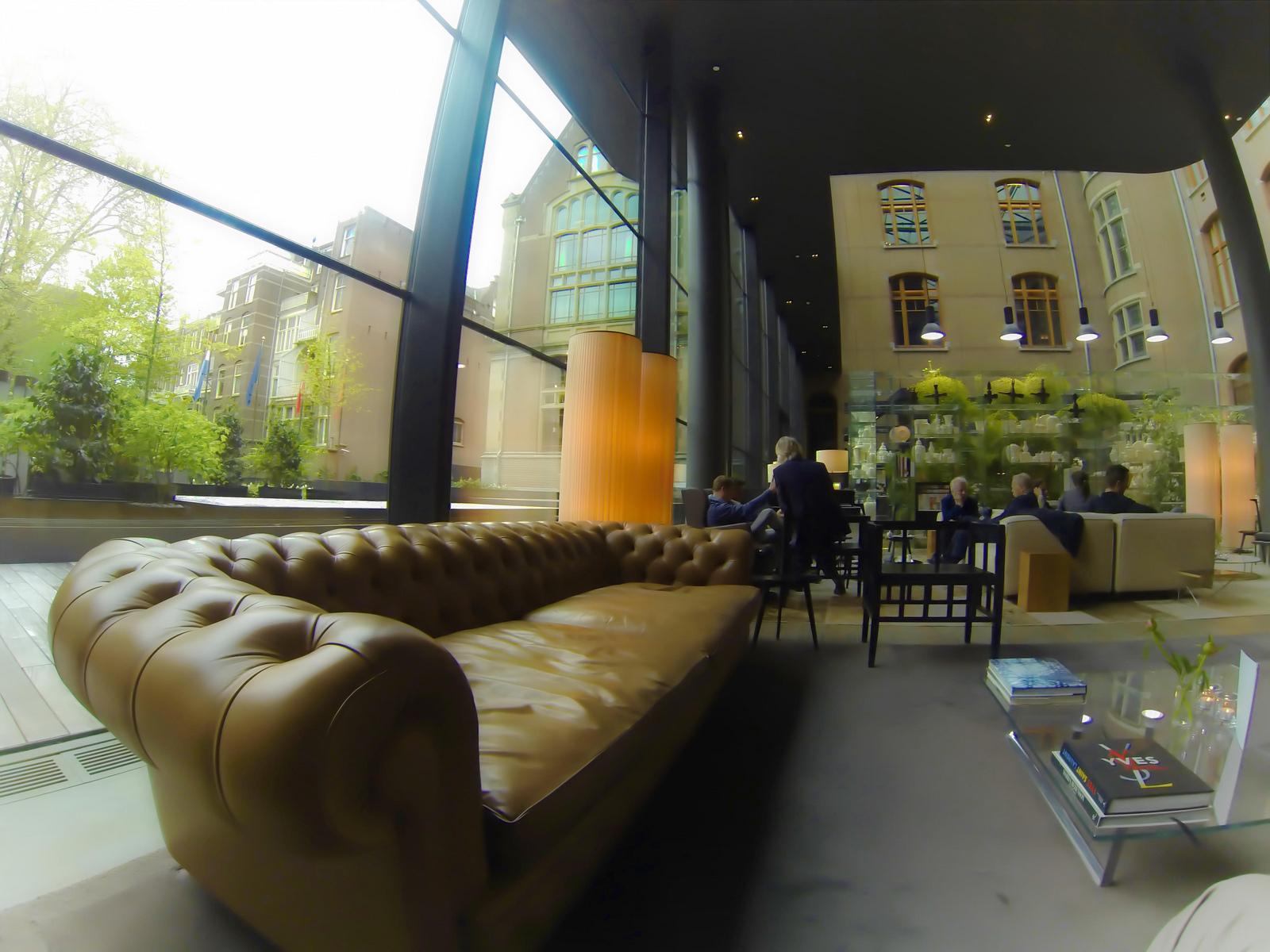 chesterfield-sofa-low-coffee-tables-lobby-conservatorium-hotel-amsterdam.jpg