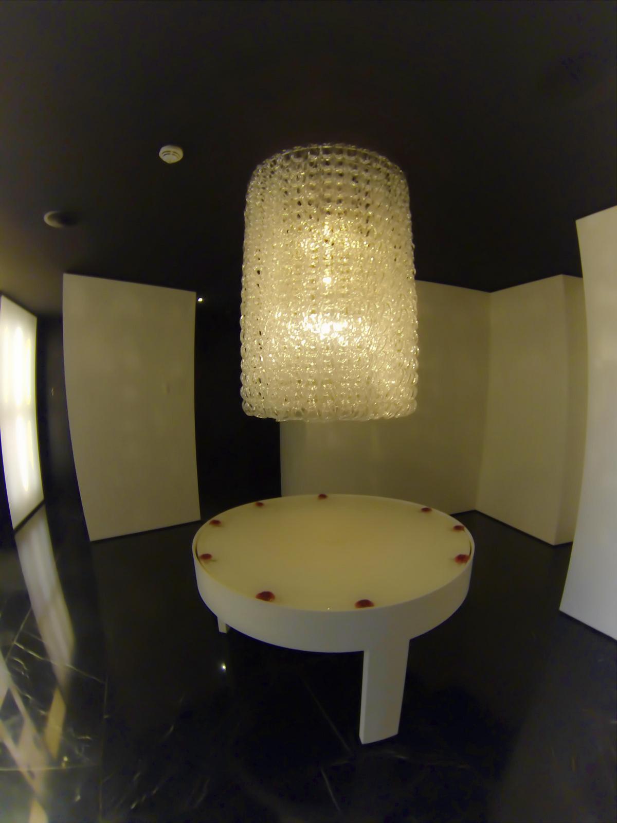 conservatorium-hotel-amsterdam-chandelier-table-fountain-outside-public-restrooms.jpg
