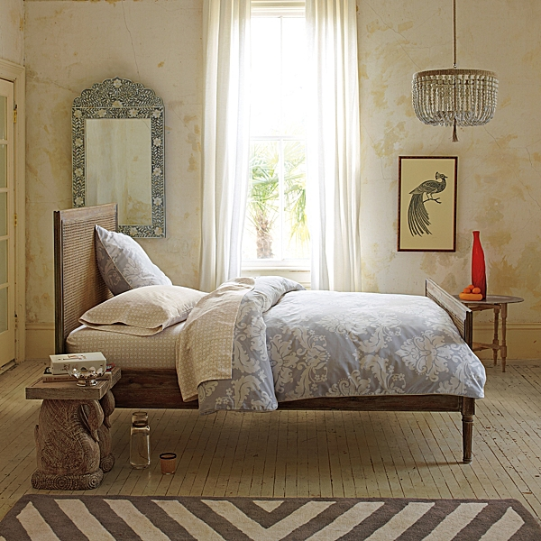 You can confidently float this chic Harbour Cane bed in the room - it's that clean and strong.