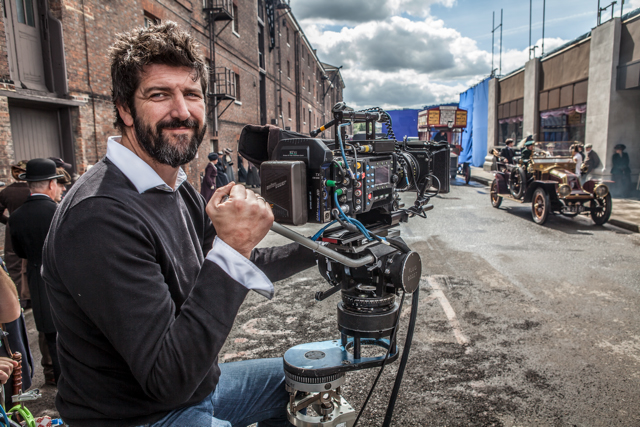DoP John Conroy on the set of Mr Selfridge with Arri Alexa in hand
