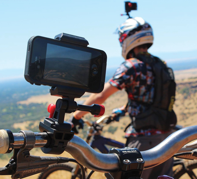 VeloCity Clip rigs on handlebars and helmet. Also on a chest harness.