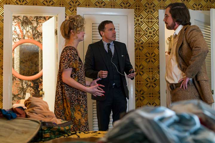 Director David O. Russell with actors Christian Slater and Jennifer Lawrence.