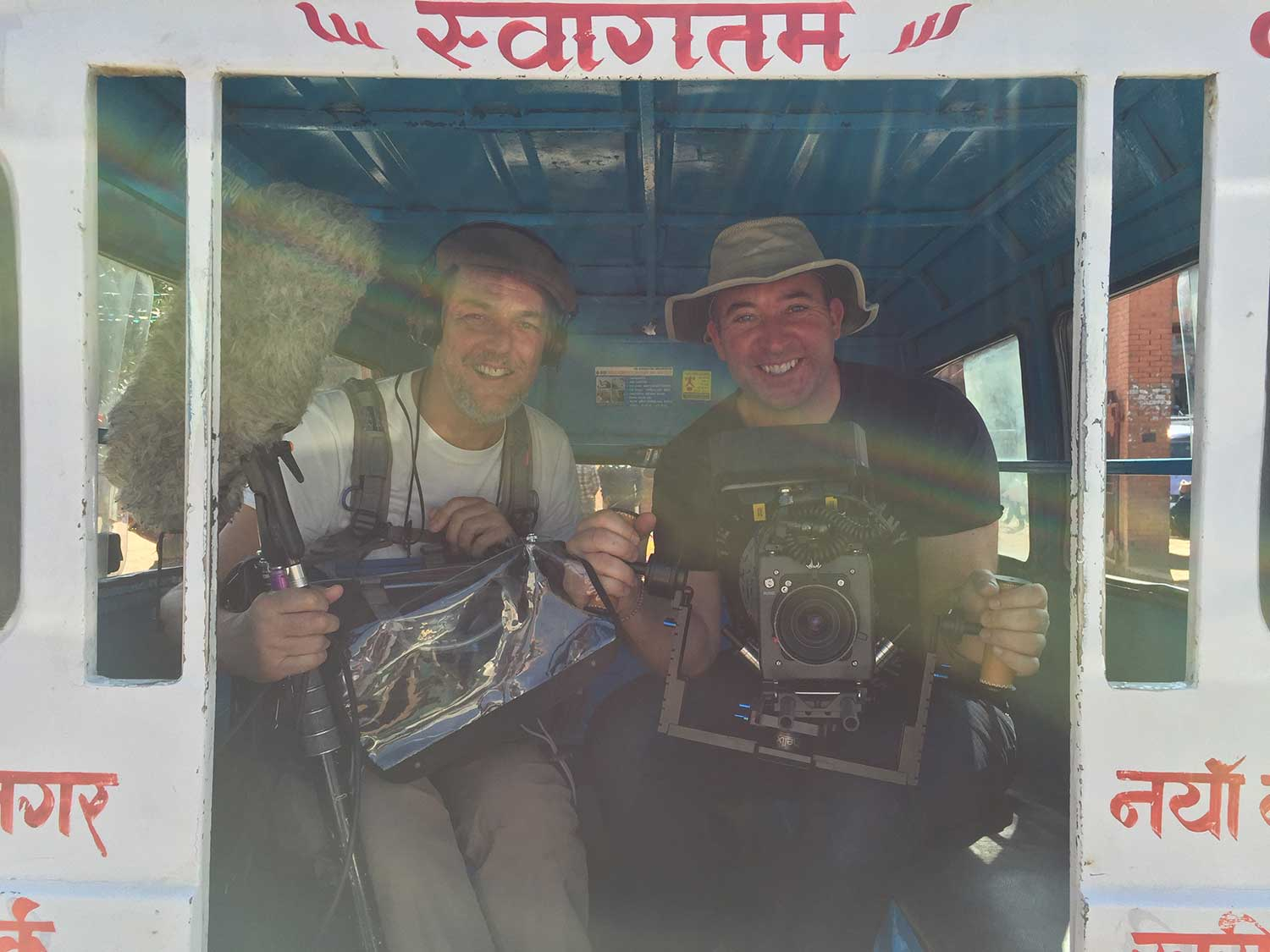 DoP Johann Perry and his sound man on-board a Nepalese Tuk-Tuk getting ready to shoot Beckham among the 1,000s that turned up.