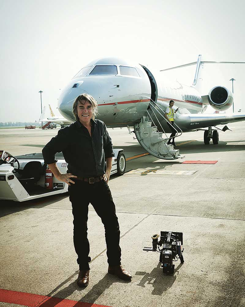 DoP Neil Harvey with Arri Mini camera and his mode of transport for the nine days in the background.