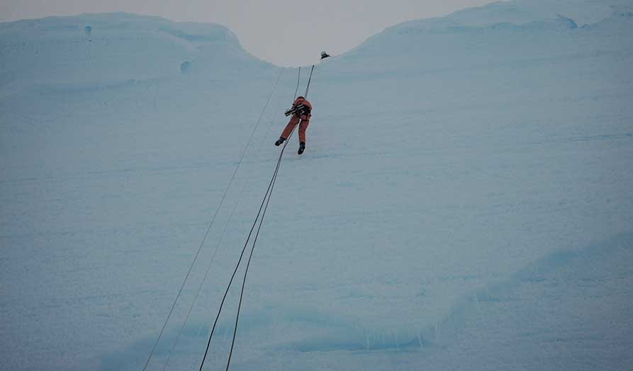 David with Arri Mini abseiling down the ice crack.