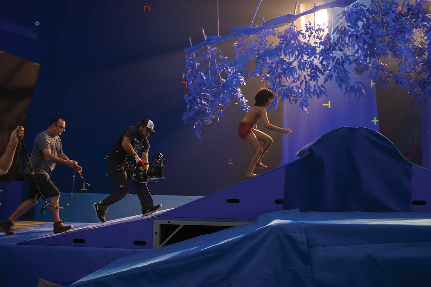 Above: The ARRI Alexa Studio camera follows Mowgli on-set. Simulcam gives the live production crew an idea of where the CG is and the lighting design has already been set through extremely photo realistic software in Maya or Renderman.