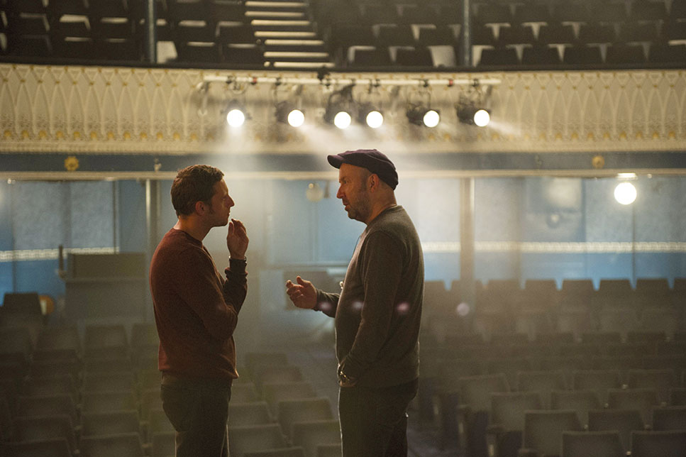 ABOVE    Director Paul McGuigan on set with actor Jamie Bell