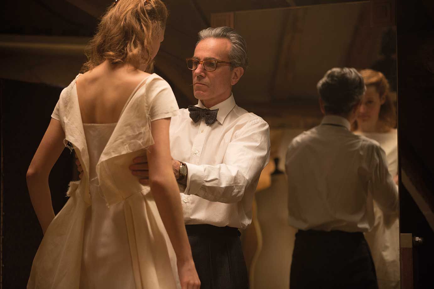 Daniel Day-Lewis on set with Vicky Krieps.