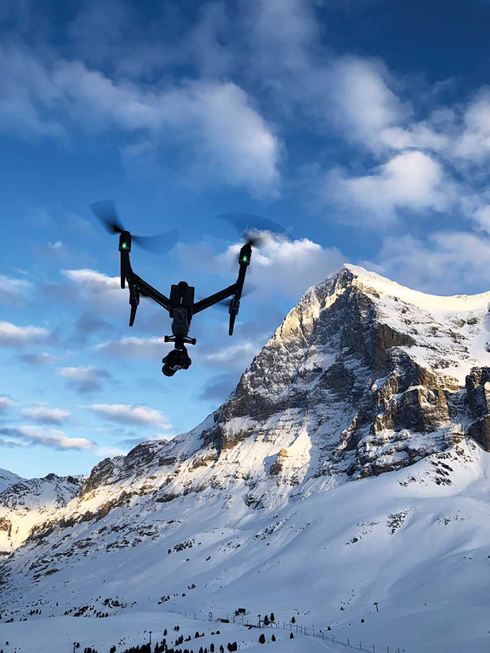 Helicopters have the edge on drones for fast longer focal length work but the new DJI X7 drone can replicate that