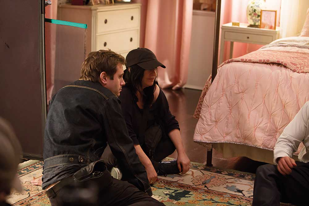 Lynne Ramsay (director) and Tom work through creative decisions on set.