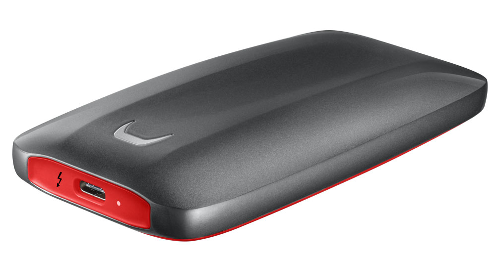 """Samsung Electronics Co Ltd has unveiled a new portable SSD, the X5, its first NVMe-based SSD. Using Thunderbolt technology, the new X5 is claimed to offer exceptional speeds in a compact and durable form factor, ideal for DOPs and those working with 4K footage or real-time 3D rendering.  """"As a leader in high-performance and reliable storage solutions, we are thrilled to continue to advance the external SSD market with the introduction of our first Thunderbolt 3 portable SSD,"""" said Dr Mike Mang, vice president of Brand Product Marketing, Memory Business at Samsung Electronics. """"The X5 is yet another testament to Samsung's commitment to providing innovative portable storage solutions that enable faster transfer of large data files, saving users' valuable time.""""  Thanks to Thunderbolt 3's 40Gbps bandwidth –up to 4x faster than USB 3.1 –Samsung claims the X5 offers a read speed of up to 2,800 MB/s, which is up to 5.2x faster than the widely used SATA interface portable SSDs and up to 25.5x faster than external HDDs. The drive also boasts the fastest maximum write speed of 2,300 MB/s, enabling users to transfer a 20GB-sized 4K UHD video in just 12 seconds,according to the company.  With its full-metal body, a glossy finish and non-slip bottom mat, the X5's shock-resistant internal frame and rugged metal housing can withstand accidental drops of up to two meters. In addition, the Dynamic Thermal Guard technology and a heat sink safeguard the X5 from overheating, ensuring reliability while maintaining optimal operating temperatures. The X5 also offers powerful data protection with Samsung Portable SSD Software, based on the AES 256-bit hardware data encryption, including optional password protection and easy configuration of security settings.  The X5 comes with a three-year limited warranty and will be available from 3 September, with suggested retail prices of £359.99 for the 500GB model, £629.99 for the 1TB model and £1,249.99 for the 2TB model.   samsung.com/portable-s"""