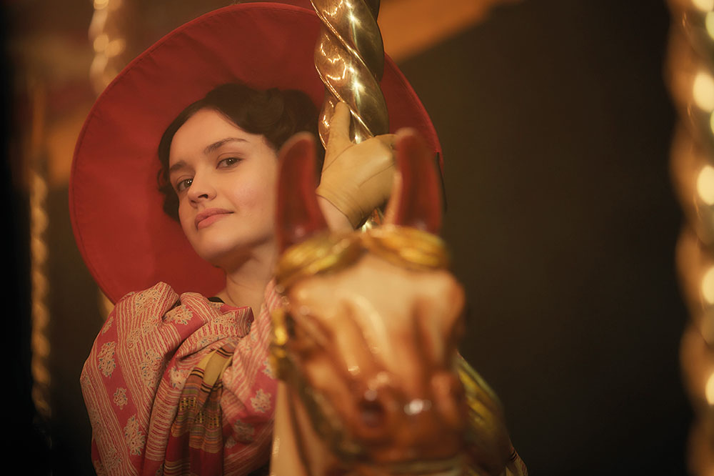 Olivia Cooke as Becky Sharp breaks the fourth wall with one of the show's signature looks to camera.