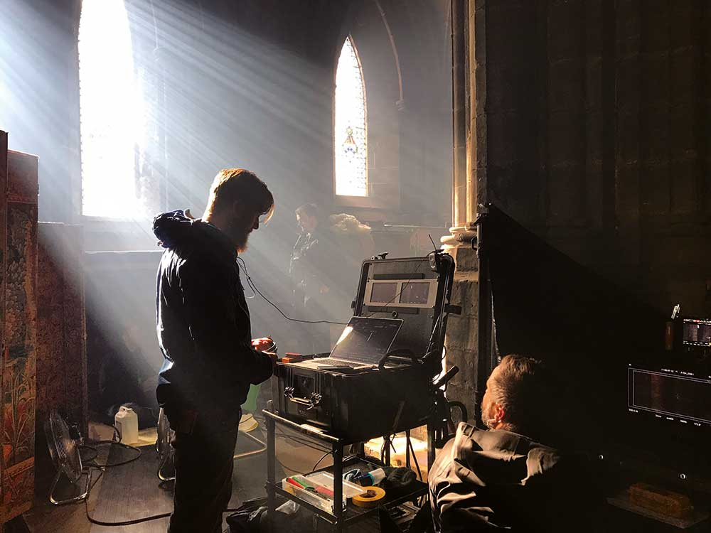 Video playback operator James Edgcombe and DIT Sam Spurgeon set up for a shot at Glasgow Cathedral.