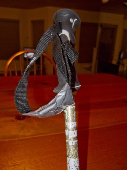 A bit of duct tape making a loop on the pole to get little mitts and gloves through.