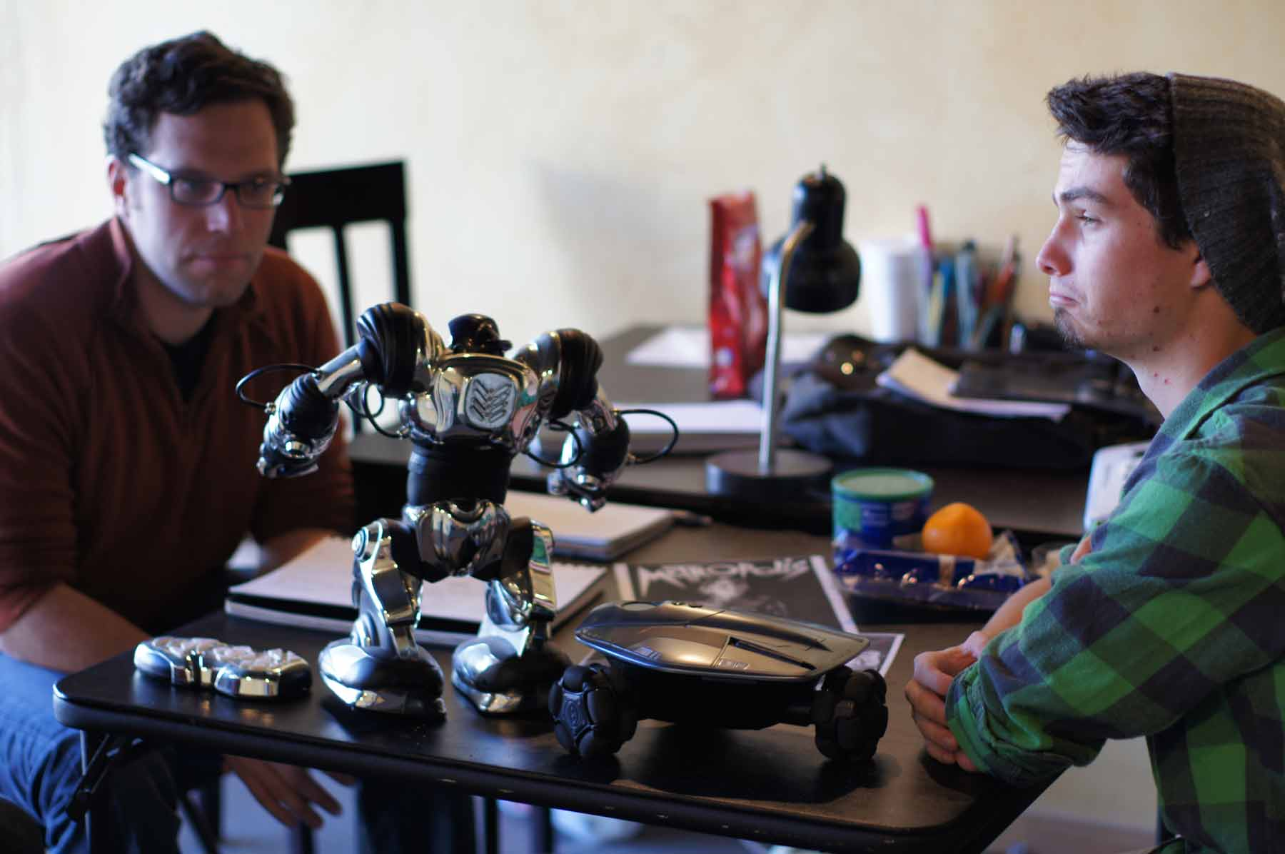 High-schooler (R) Matthew Alexander made his professional acting debut at ion in the 2010 San Diego premiere of  Song of Extinction  by E.M. Lewis. In 2012, he led the design team for the robots in  Heddatron .
