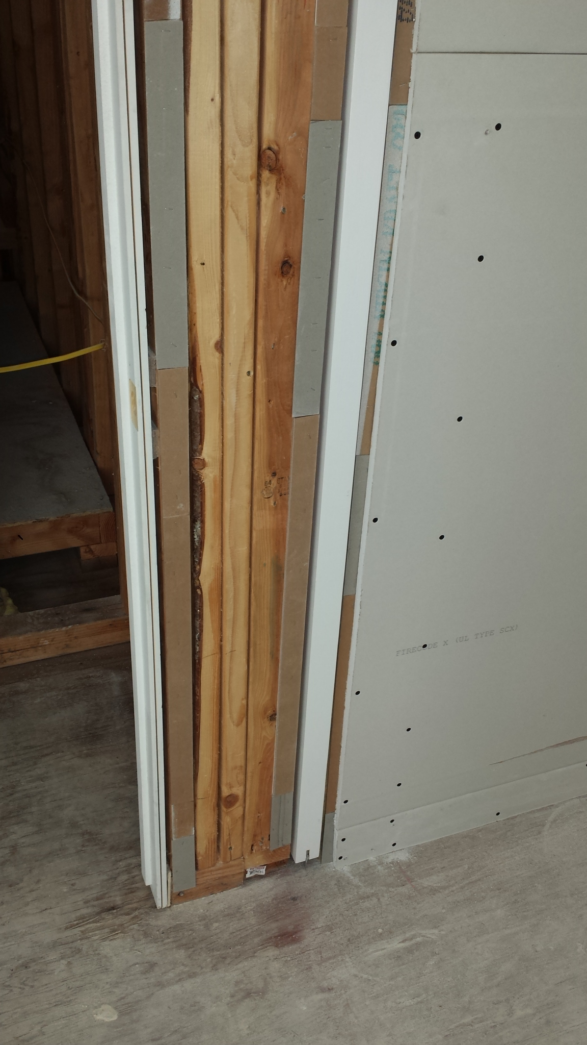 After the door is hung, the drywallers begin to close up the opening.