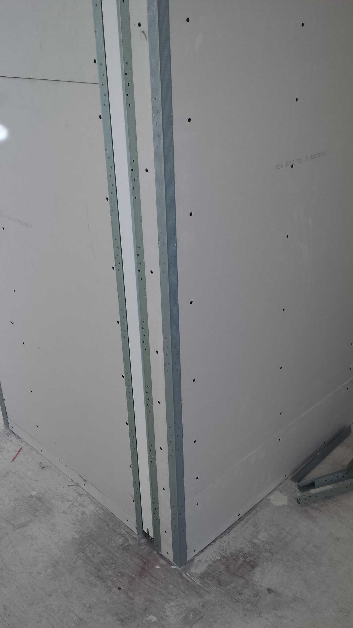 After the drywall is hung next to the opening, the drywall guys install edge metal around the opening. This allows a clean finish right up to the opening of the pocket.