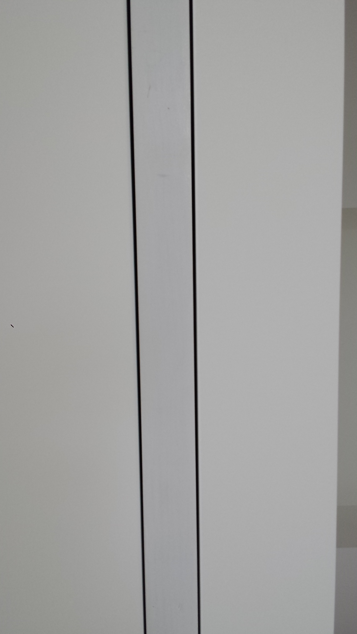 Note the nice even alignment of the edges of the drywall. Seeing the finished product makes it seem all too easy. But custom pocket doors definitely take craftsmen that know what they are doing. It done right, they are beautiful and very functional.