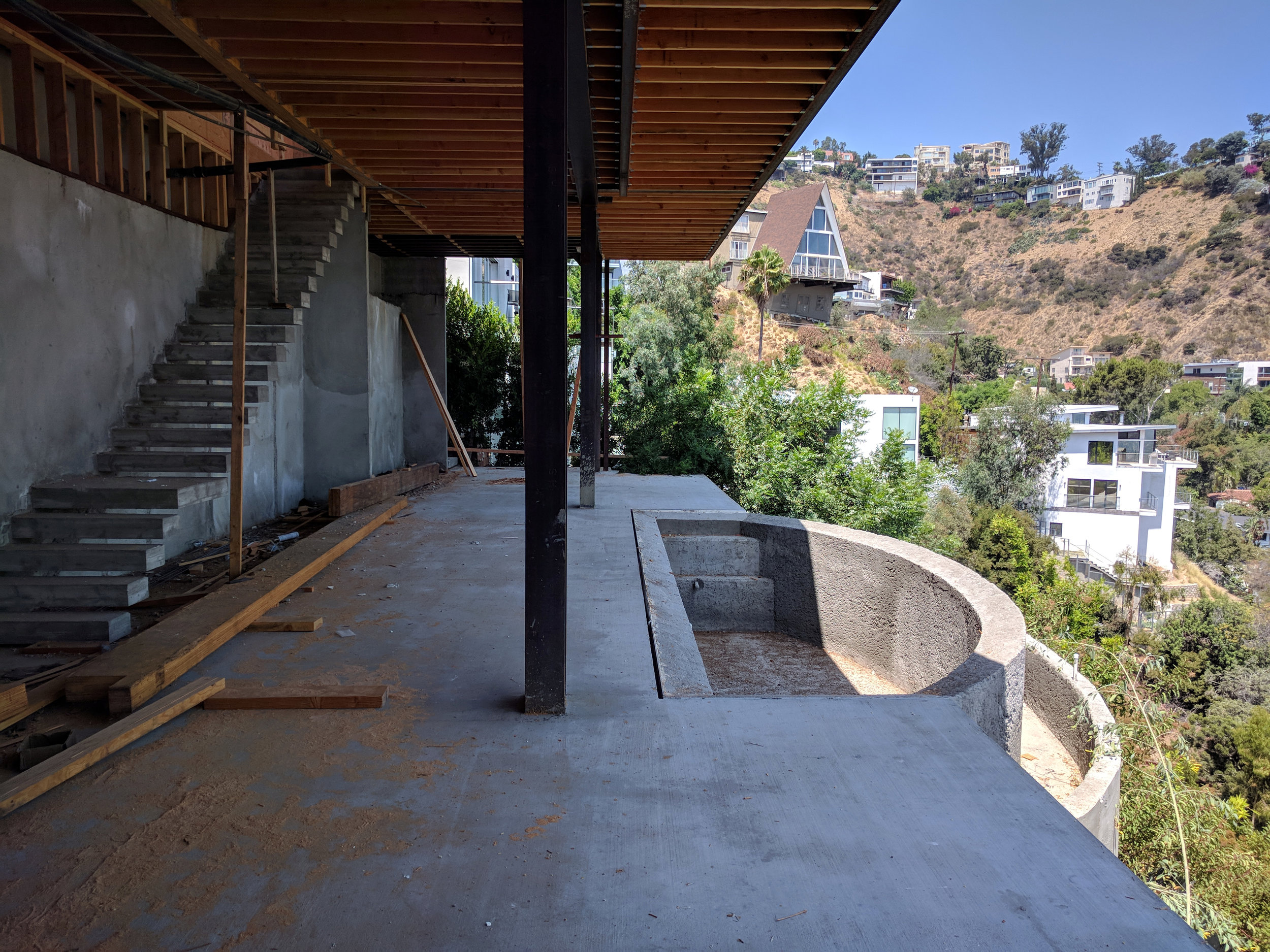 """Lower Level. Note the floating stairs. The stairs cantilever from the wall. Ceilings are 14'-0"""" in height."""