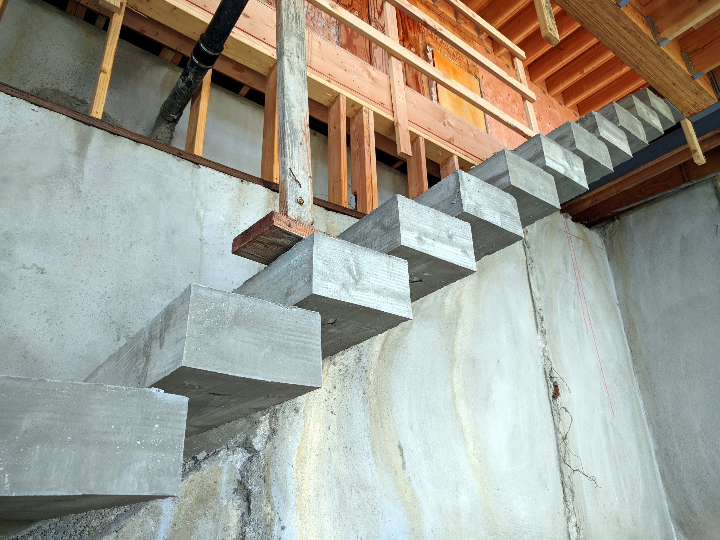 Cantilevered stairs-Between Lower Level and Main Level.