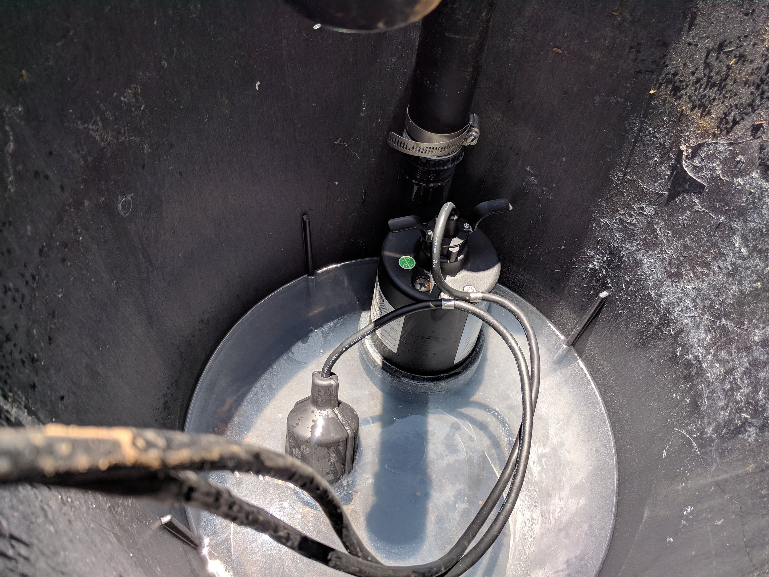 Pump sits at the bottom of the basin