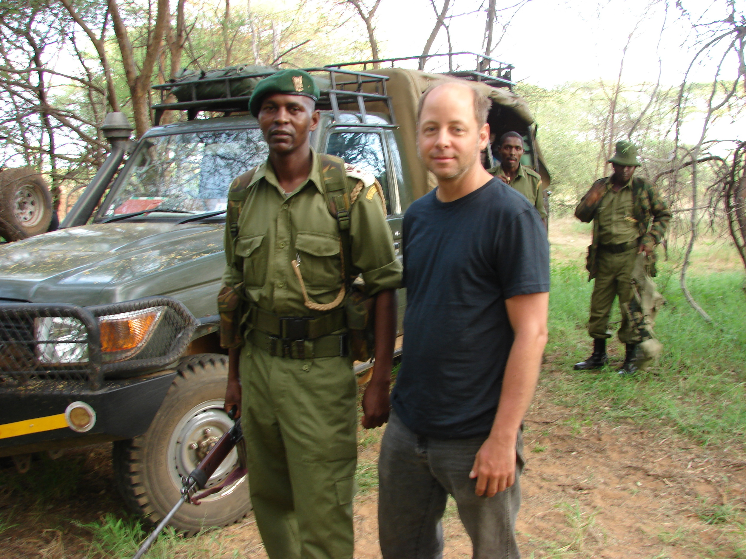 Kevin (center) with Commander Michael NTosho (left), filming in Kenya.