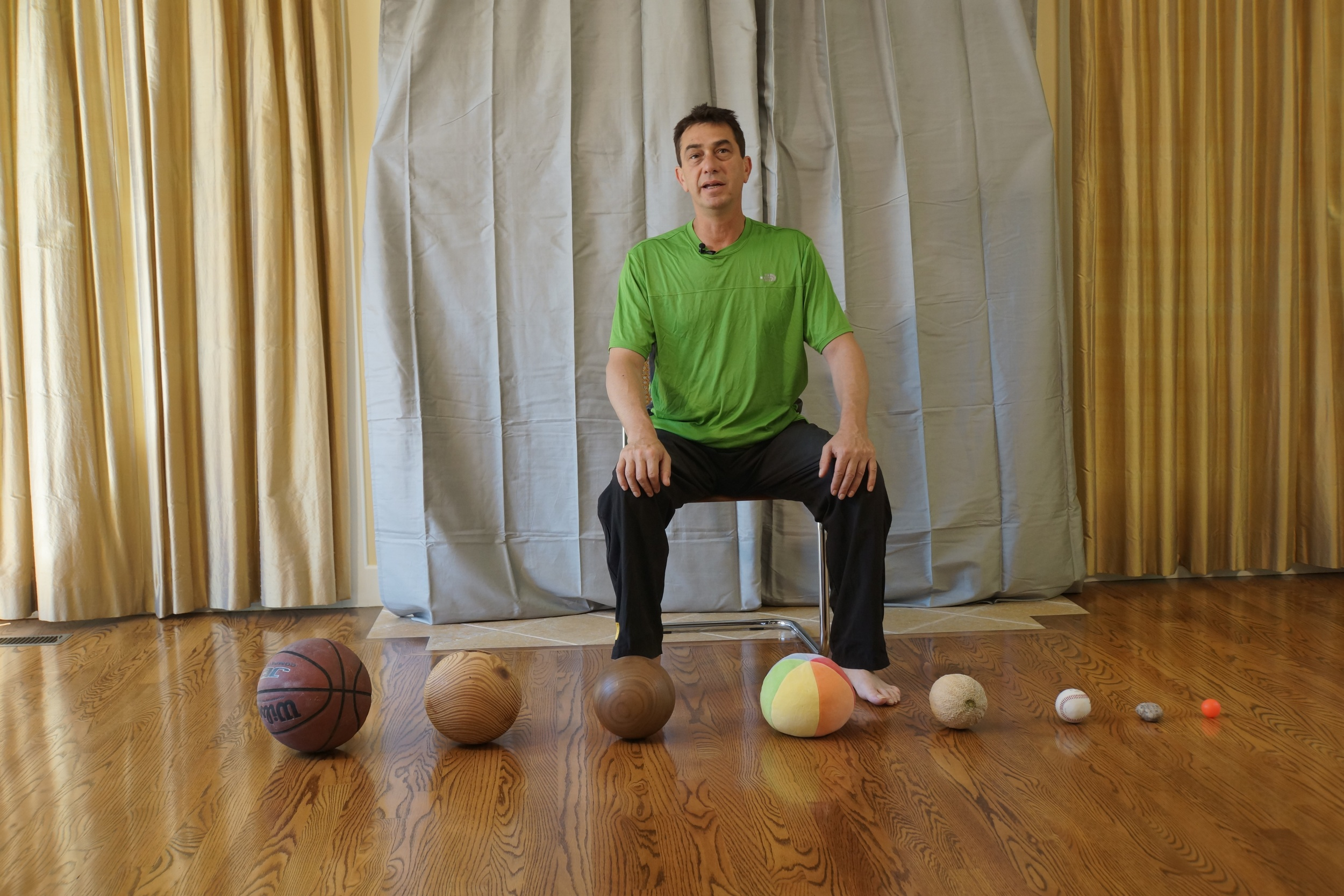 Rami Sitting with round objects.jpg