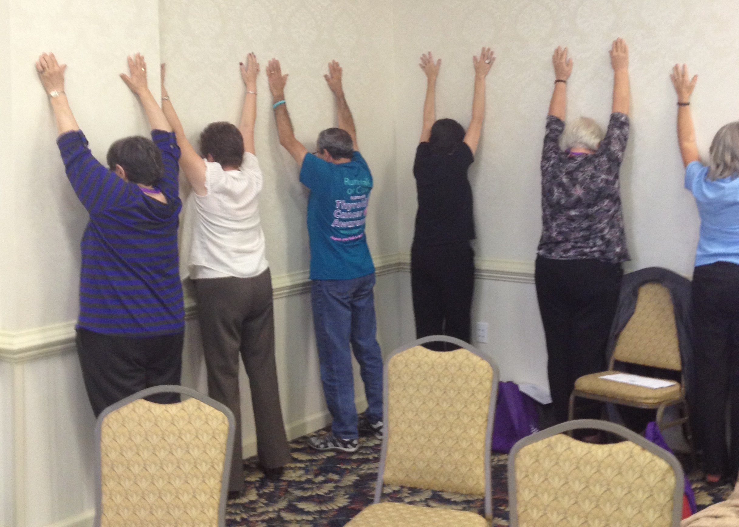"""Several students doing """"Iron on the wall"""", one of Rami's favorites."""