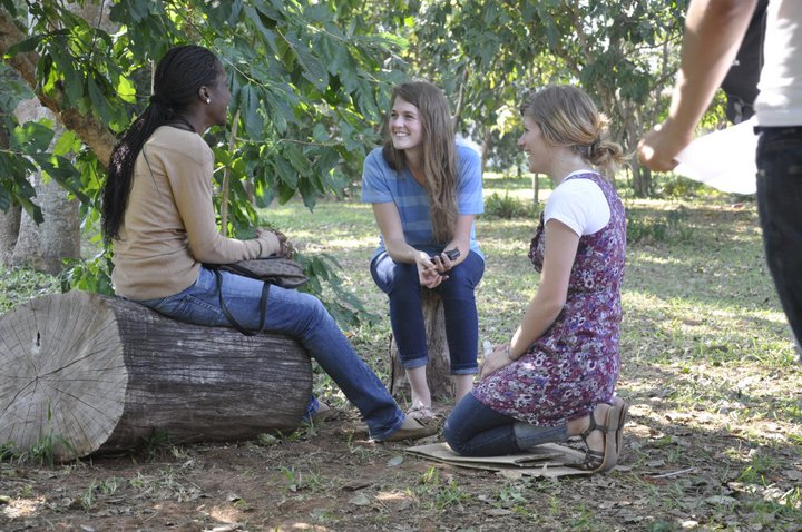 andrea and mindi talking to a girl on campus