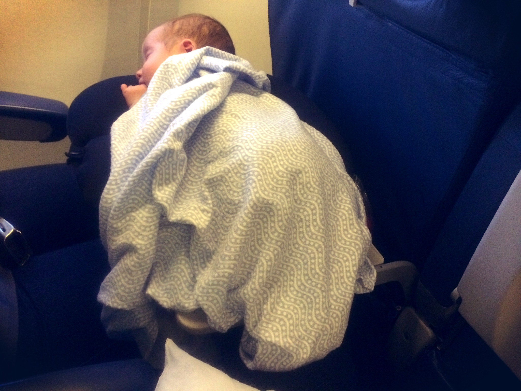 Seat-back tray tables make comfy beds