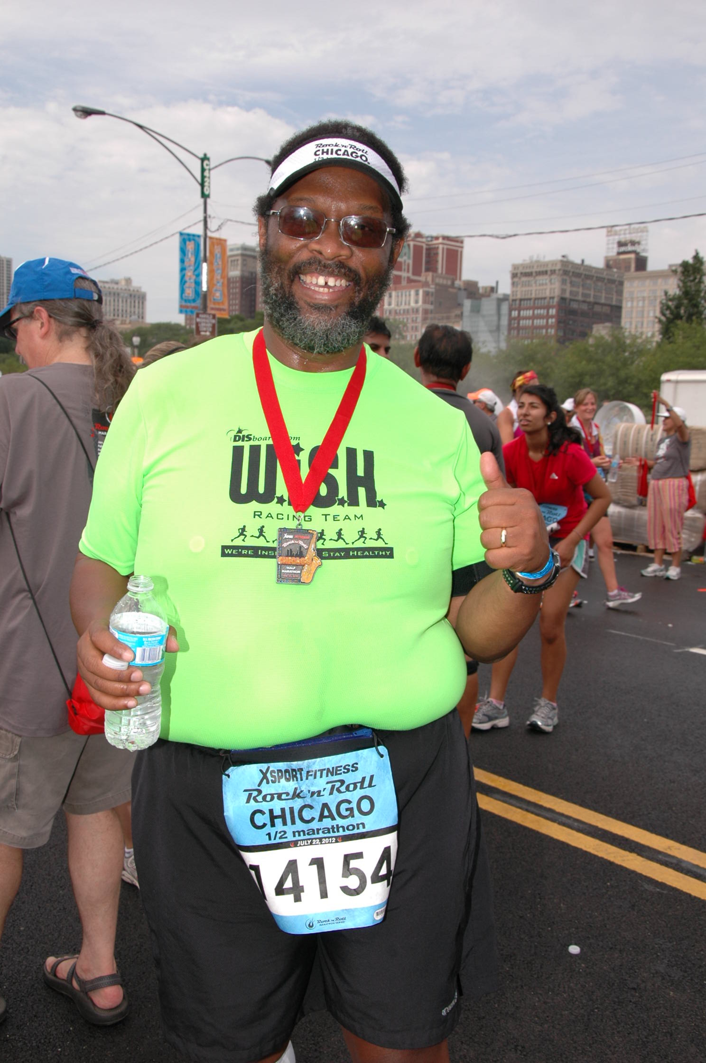 I was one happy Finisher after almost 3 hours of humidity and heat.