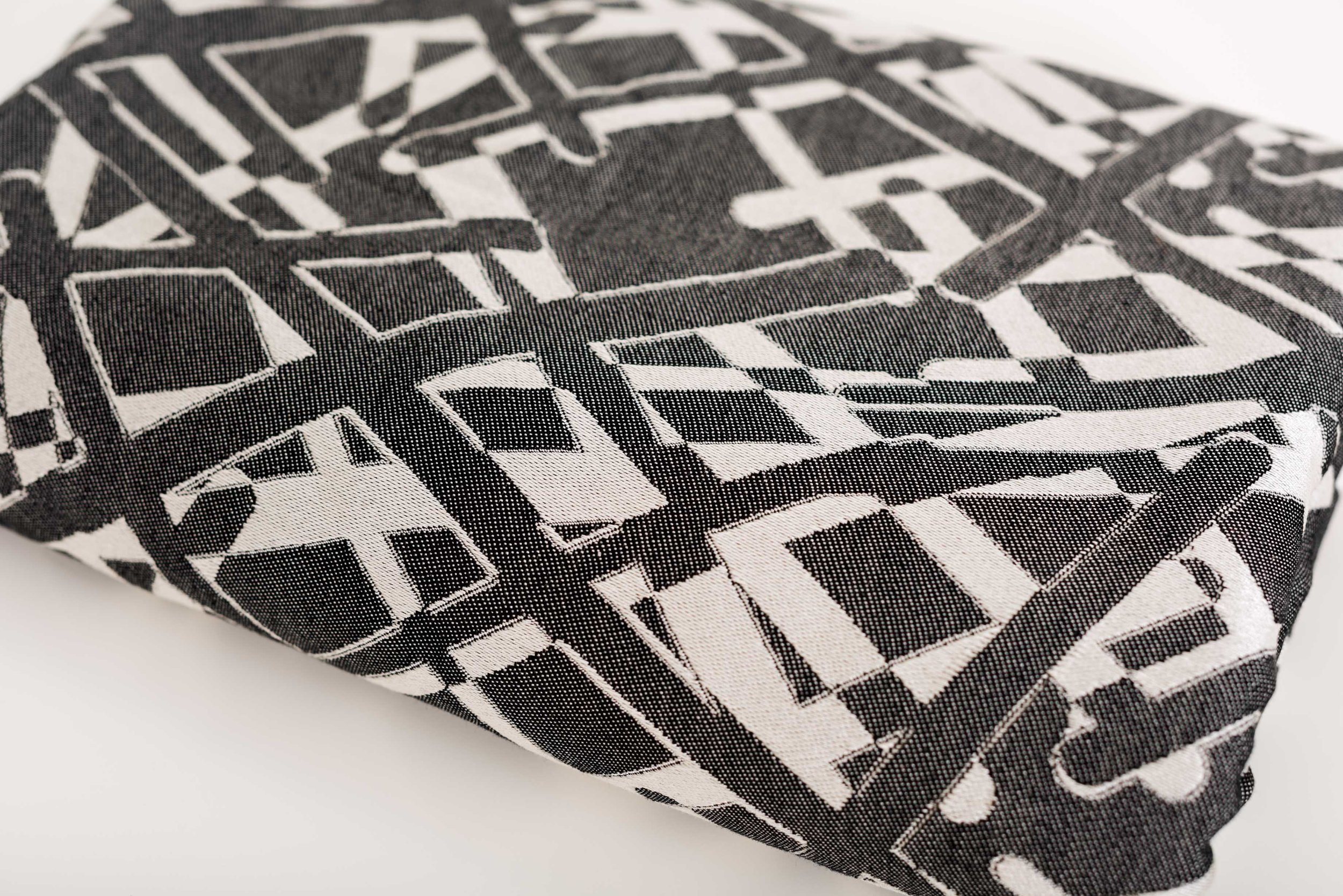 """Sticks Noir · 100% cotton  Sticks Noir, is our newest design and is debuting here in Chicago. This is the Goldilocks of wraps. Hugging the middle ground on all wrap qualities, you will find that it falls in the """"just right"""" category. This wrap is new wrapper friendly, yet advanced wrappers will appreciate its ease of use. It is great for squishes and also for toddlers. You just can't go wrong with any size, as the wrapping qualities are friendly to wrappers of all skill levels."""