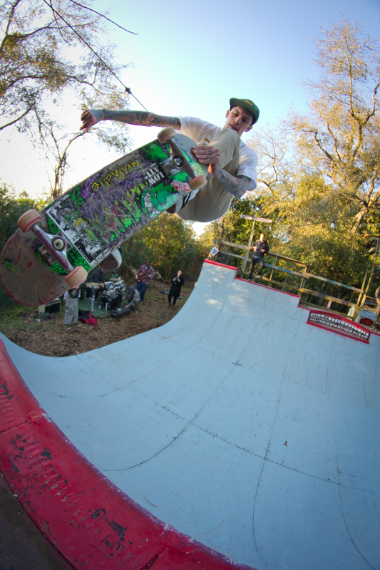 Bland lets all the kids know he skates by showing off his board scratches on a lien tail.
