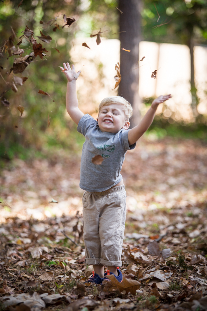 Remember the girlfriend I told you I met back in May?  I made a few trips down to see her and her son in Alabama.  This is Porter.  His leaf-throwing sums up how I feel about fall weather.