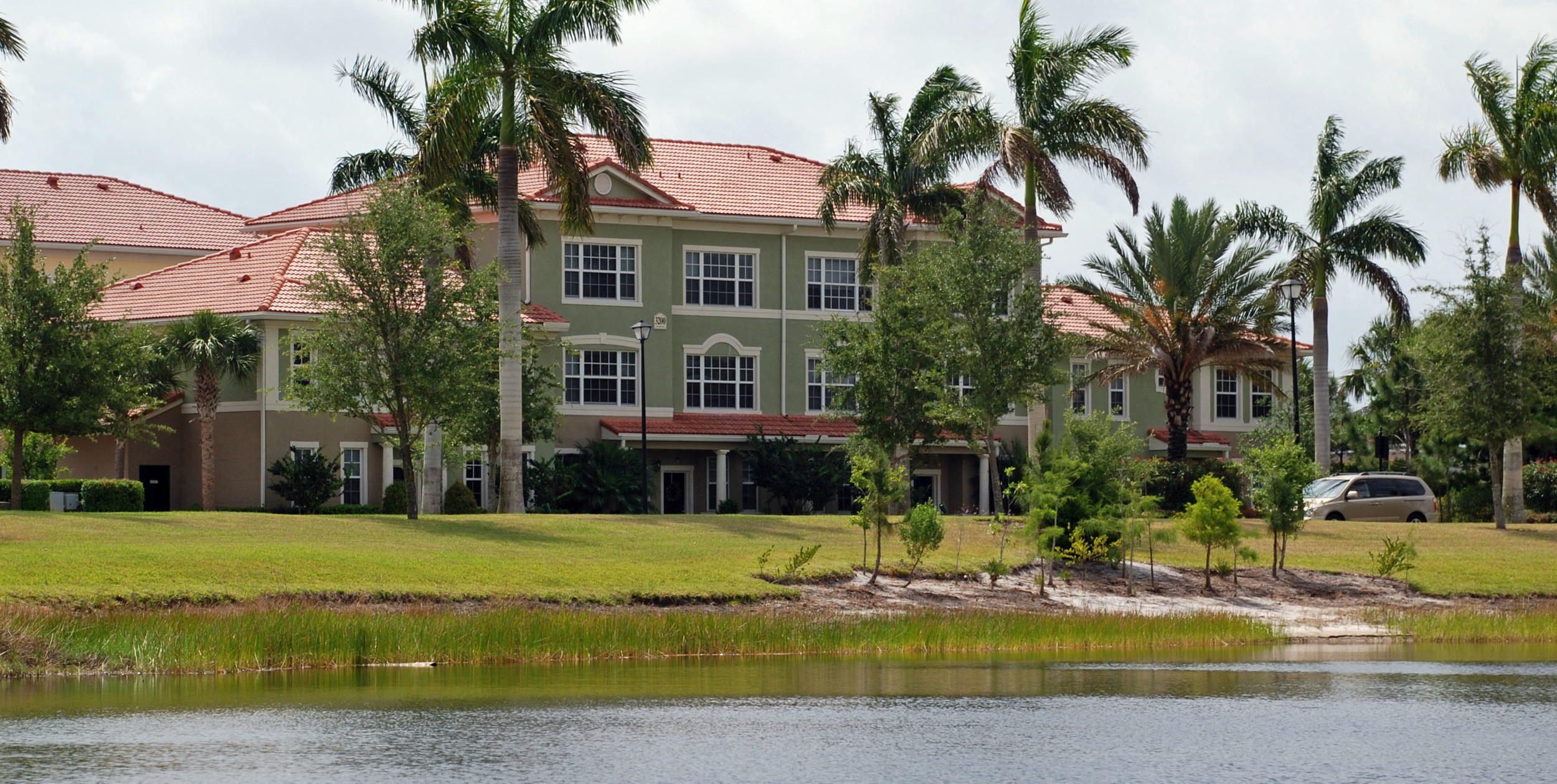 The Gables Floresta Jupiter Florida Multifamily Units Littoral Planting along Lake.jpg