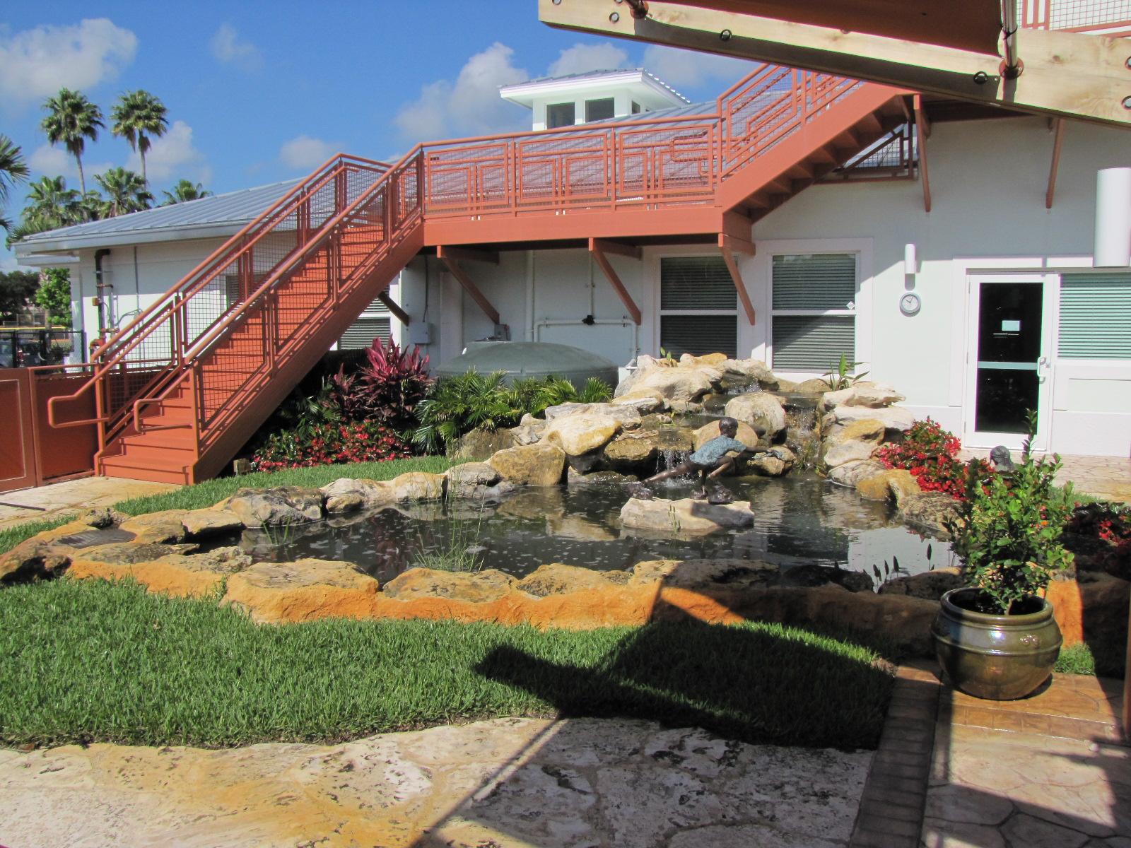Turtle River Montessori Collected Rainwater Pond.jpg