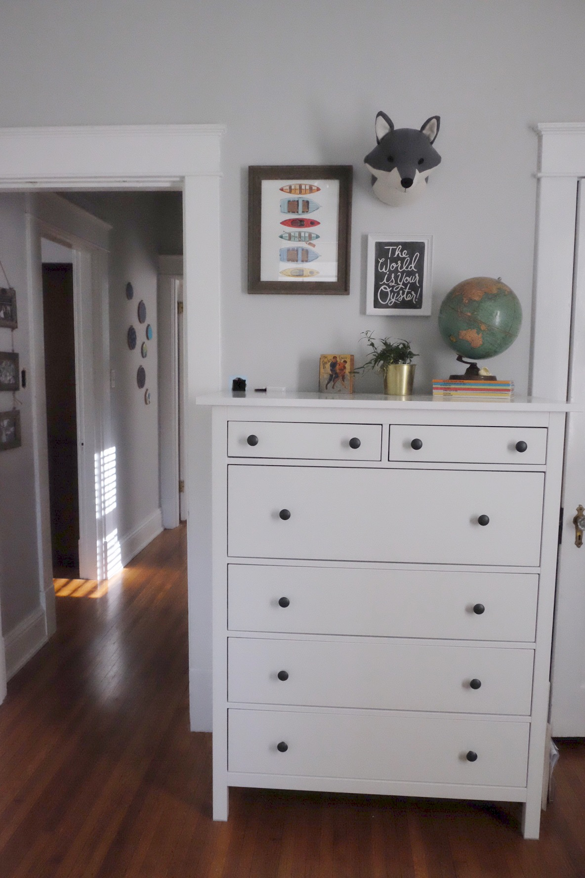 Dresser:  IKEA | Globe: vintage | Books: Vintage | Planter:  IKEA