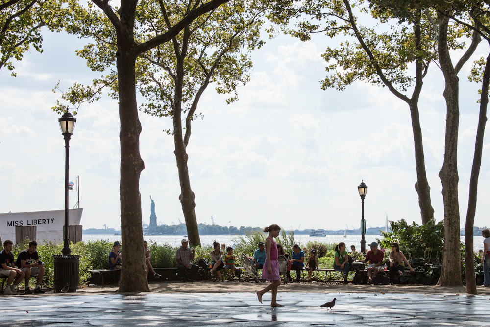 Statue of Liberty, New York City, street photography, little girl, Battery Park, freedom, play