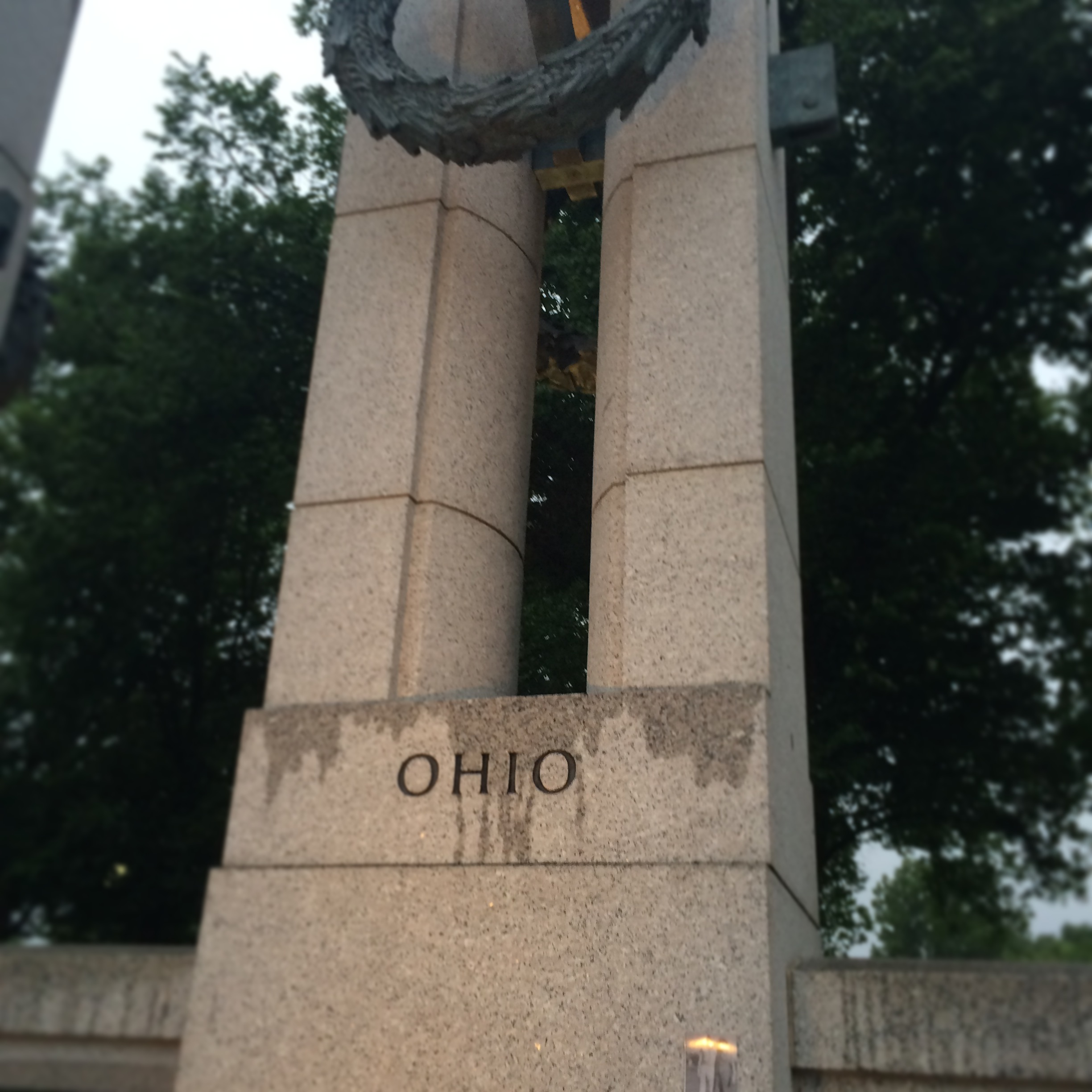 The Ohio pillar of the World War II Memorial. Note the taped photograph at the bottom right of the pillar.