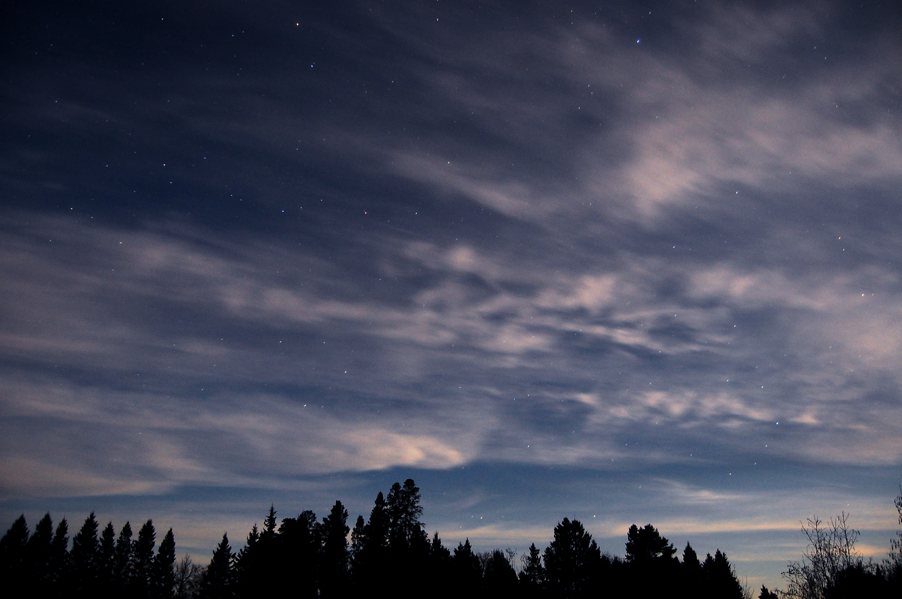 Clouds on a seemingly clear night.