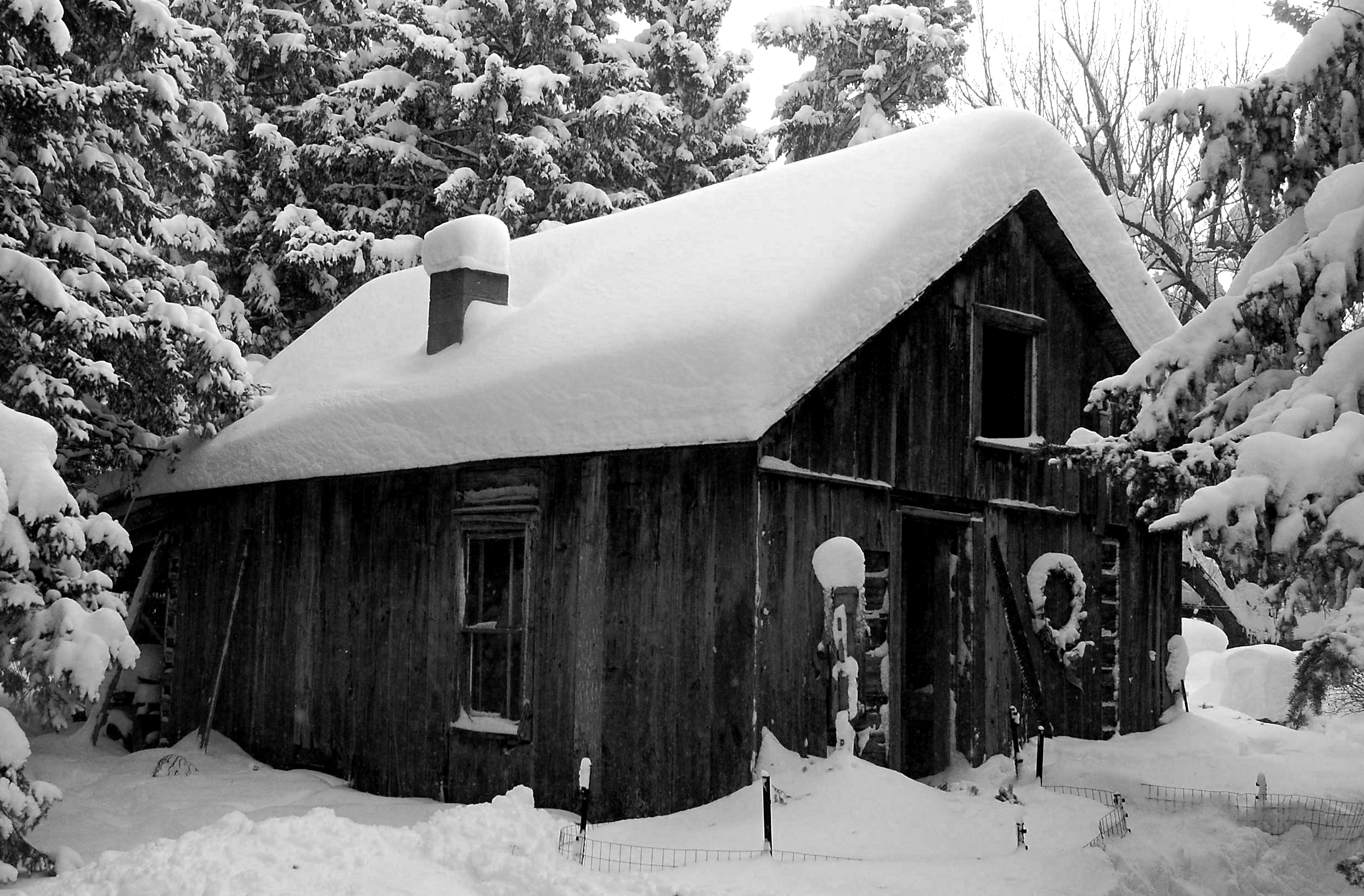 Snow covered cabin, processed Black and White.