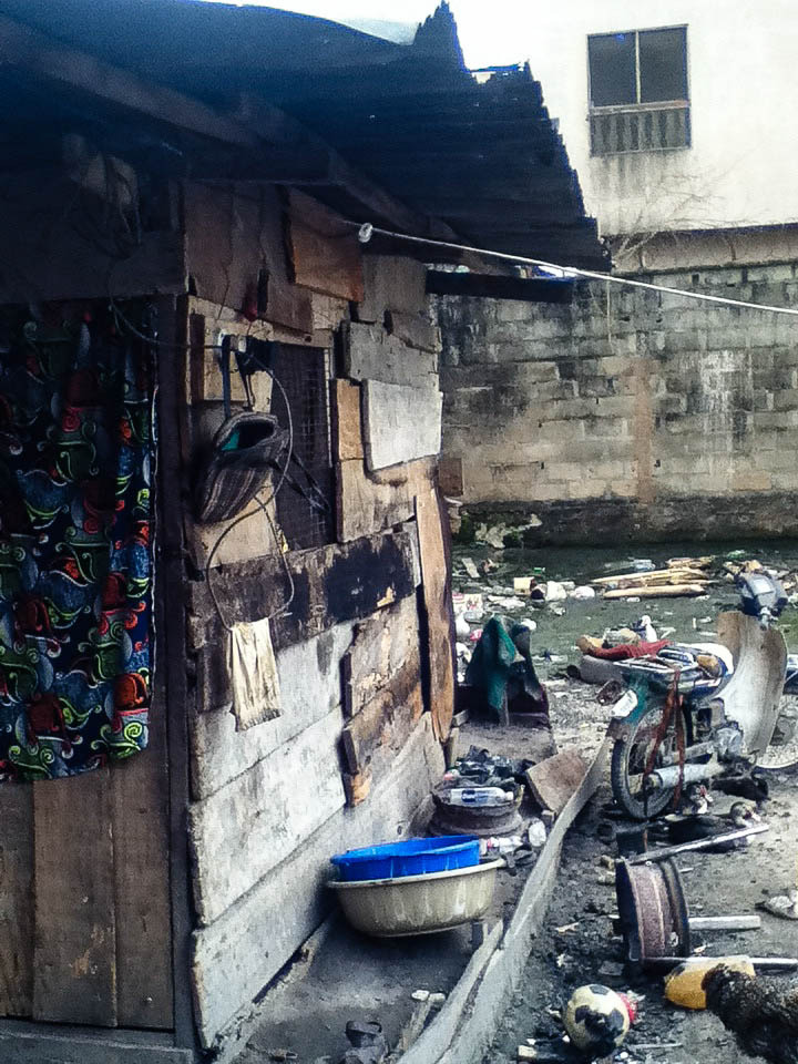 The home of Elijah, Gift and 3 other children, all under the age of 11. They live here alone on the side of a contaminated river in Ago Okota.