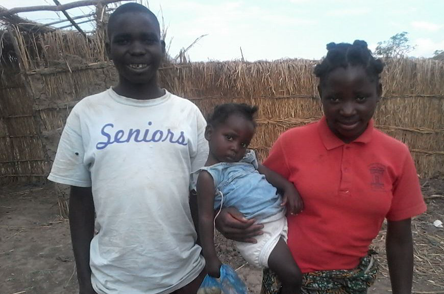 Ruthy with her older brother and sister Sibongile.