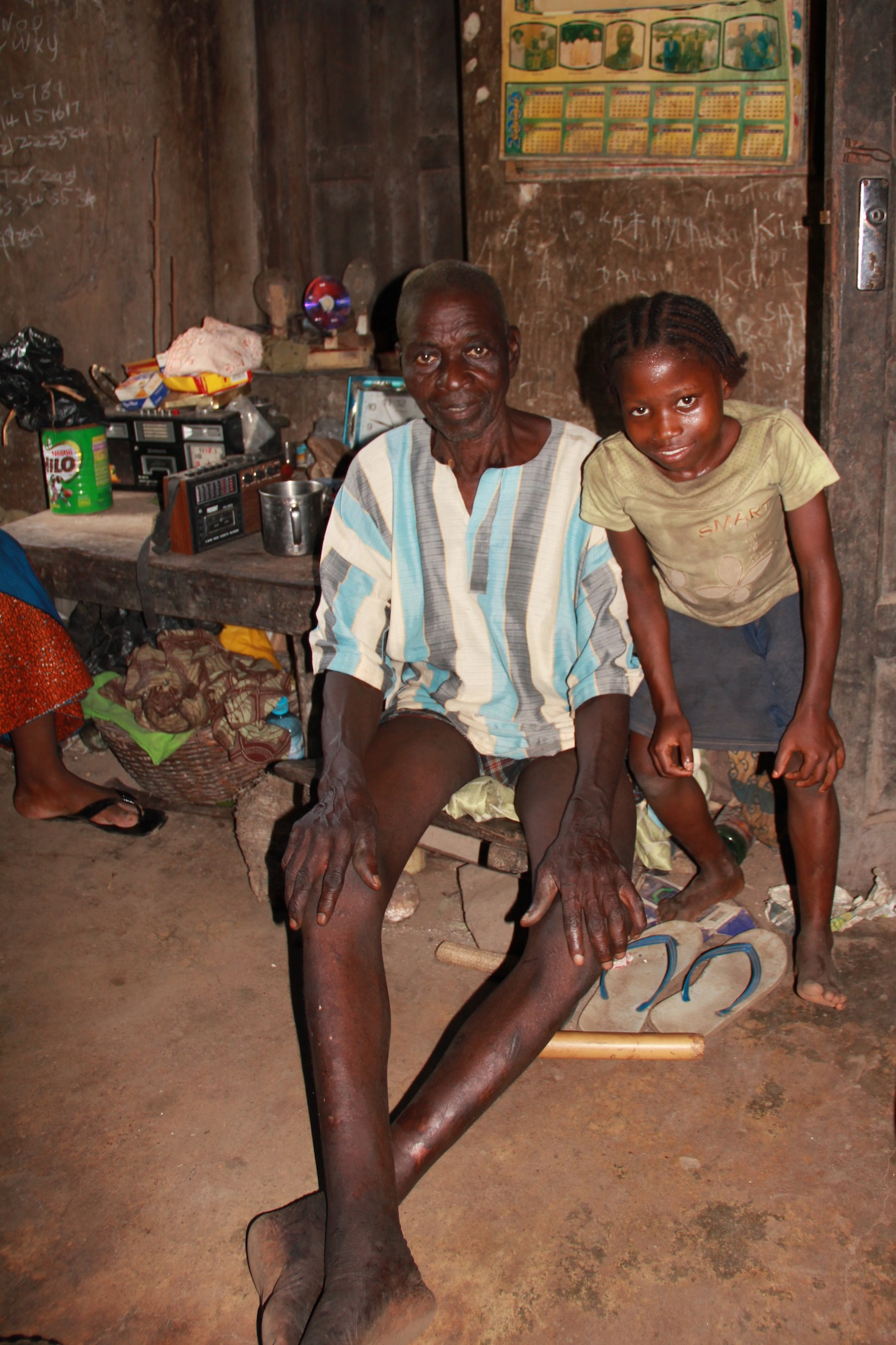 A primary caregiver with his daughter in Nigeria