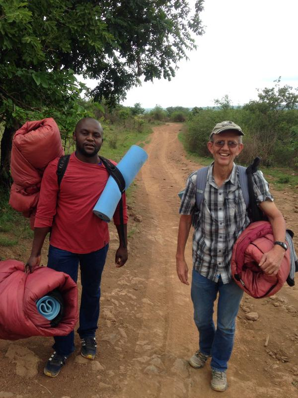 George with Bethuel, a young leader, walking in a new community in Swaziland